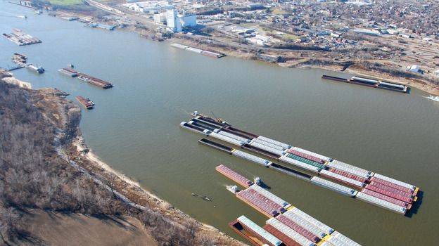 Barges last month crowded an area on the Mississippi River south of St. Louis where barges are stored, loaded and unloaded. Shippers worry that the drought-shrunken river could shut to barge traffic entirely this month. (AP)