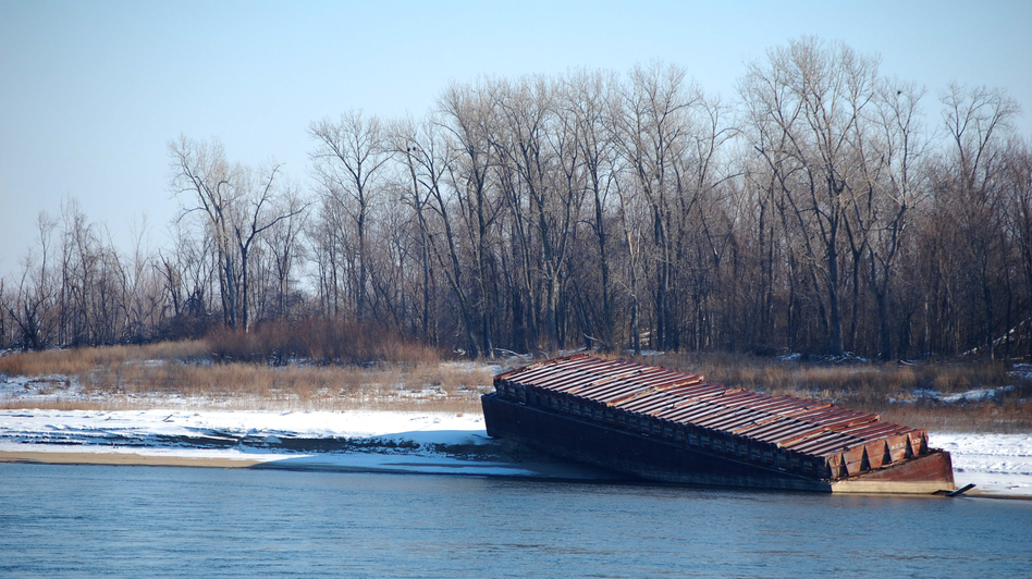 The river has fallen fast enough that barges have been beached along its banks outside St. Louis. (NPR)