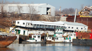 The offices of JB Marine, a barge cleaning and repair business that is located atop an empty barge just south of St. Louis, now lean at a 30-degree angle because the Mississippi River levels are so low.
