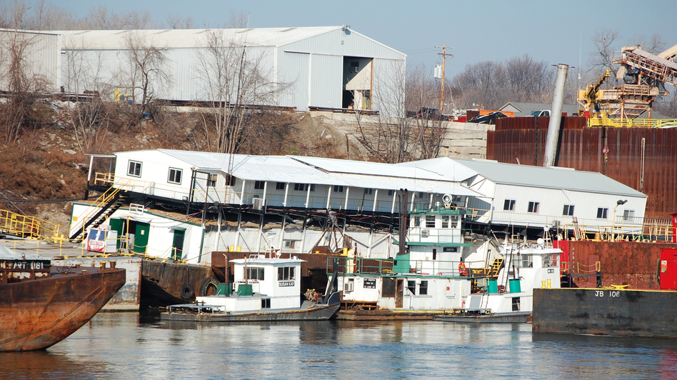 The offices of JB Marine, a barge cleaning and repair business that is located atop an empty barge just south of St. Louis, now lean at a 30-degree angle because the Mississippi River levels are so low. (NPR)