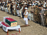 Tuesday in the Pakistani village of Khairpur, officials and relatives gathered at the coffin of the Pakistani soldier killed Sunday in a skirmish with Indian troops.