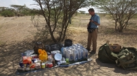 Journalist Paul Salopek, shown here with his supplies in Ethiopia, is setting out on a seven-year walk that will take him to the tip of South America.
