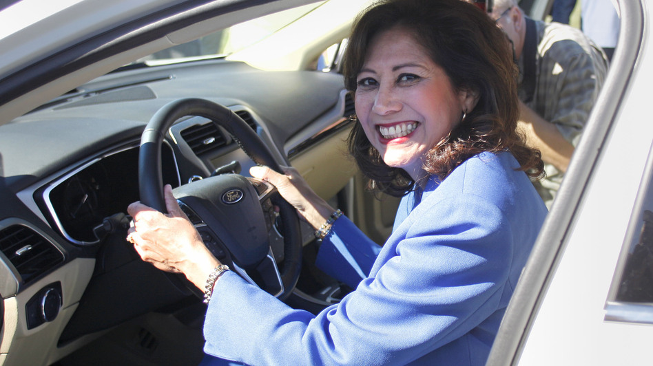 Secretary of Labor Hilda Solis, seen here sitting in a new Ford Fusion last September, submitted her resignation to President Obama Wednesday. (Getty Images)