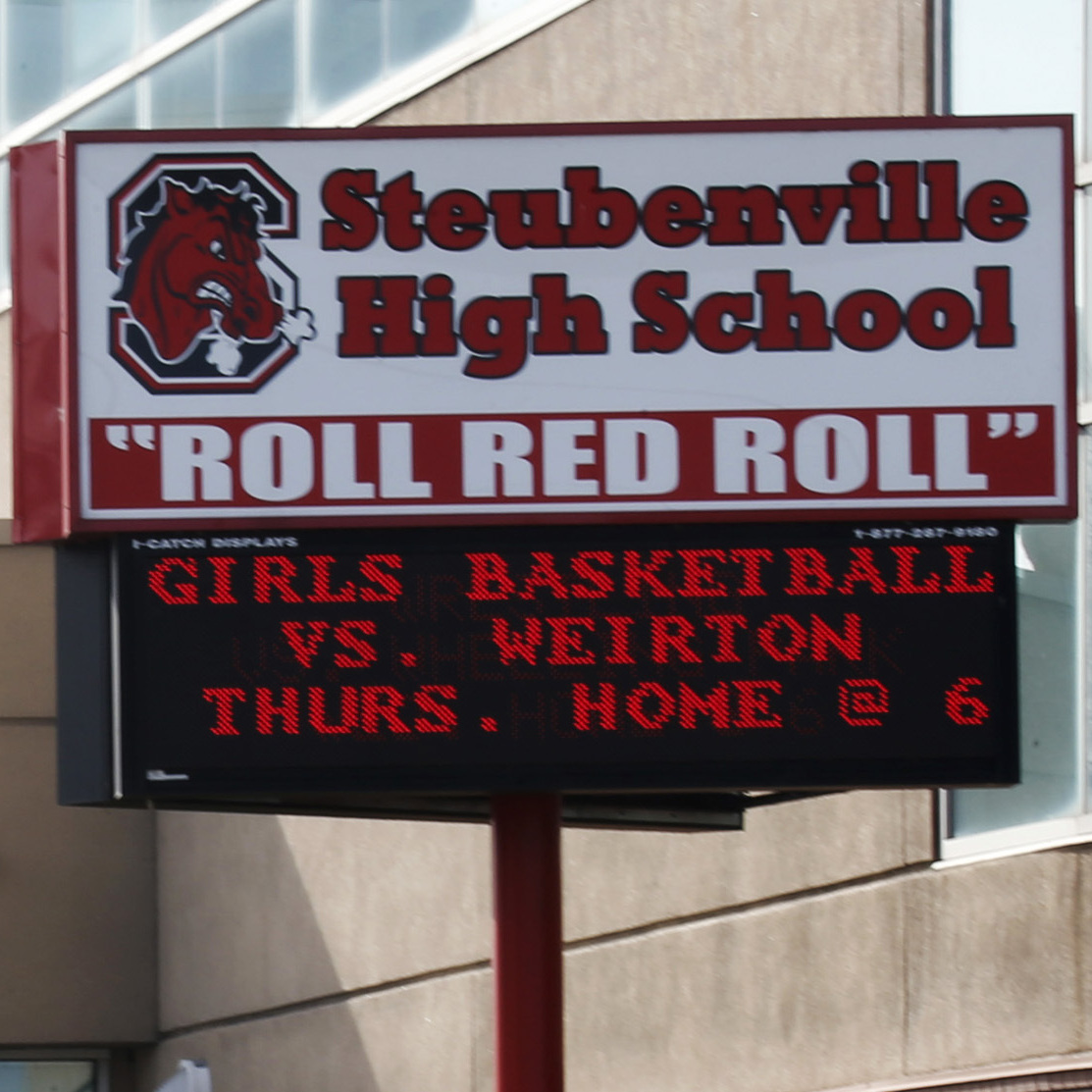 A sheriff's vehicle patrols Steubenville High School on Tuesday, after the city's schools were locked down due to an alleged shooting threat made via Twitter.