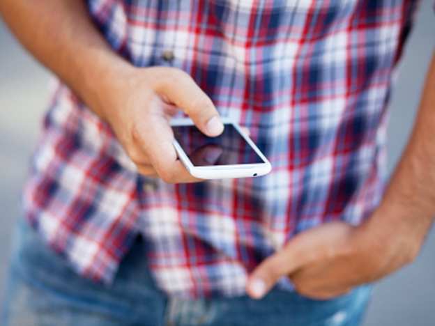 Some 23 percent of those aged 12-17 say they have a smartphone, according to the Pew Internet and American Life Project. (iStockphoto.com)
