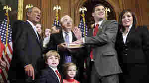 Republican House Speaker John Boehner administers the oath of office to Amash during a mock swearing-in ceremony on Jan. 5, 2011, at the start of Amash's first term.