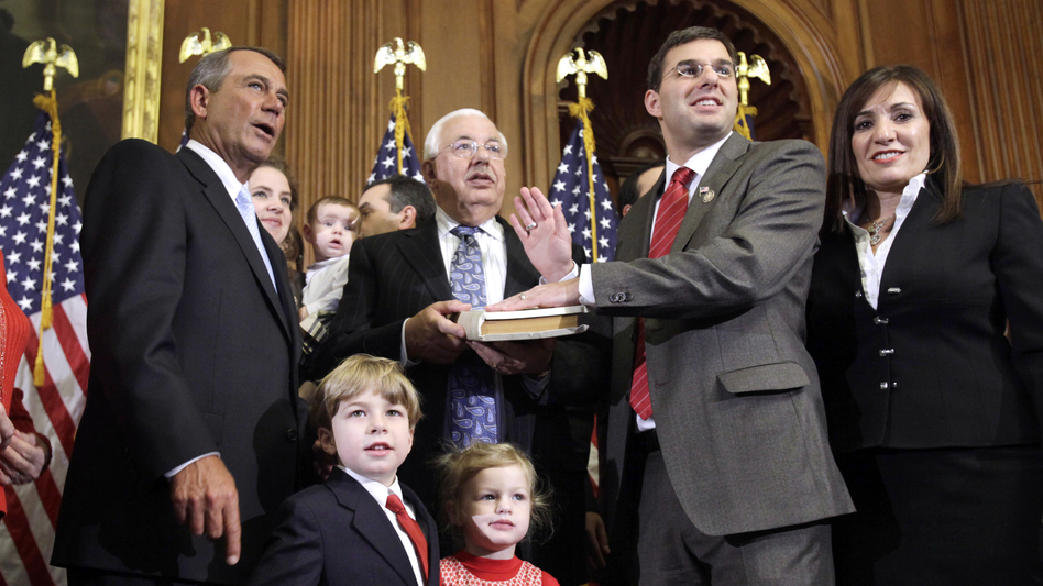 Republican House Speaker John Boehner administers the oath of office to Amash during a mock swearing-in ceremony on Jan. 5, 2011, at the start of Amash's first term. (AP)