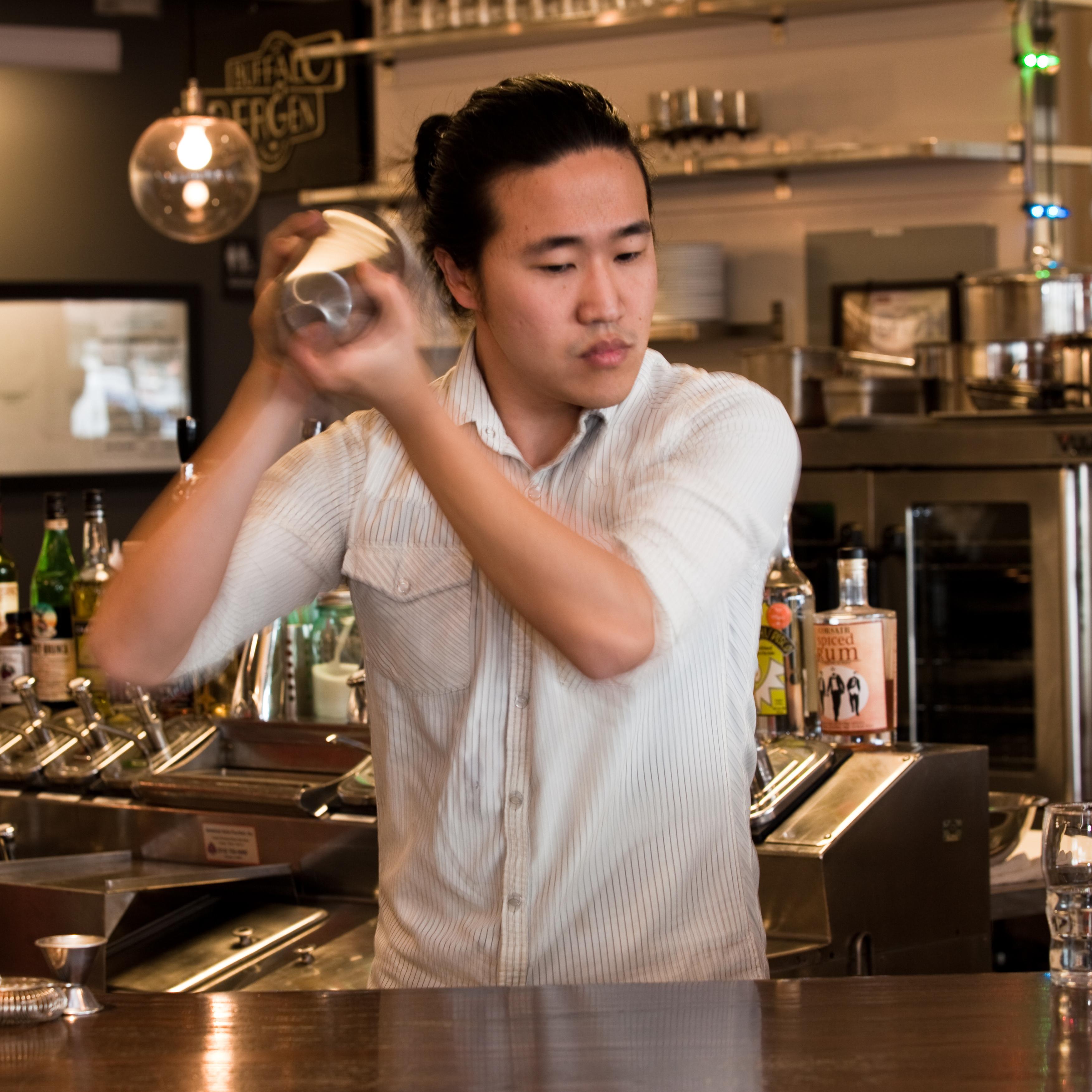 Bartender Eddie Kim prepares a Ramos Gin Fizz at D.C.'s Union Market.