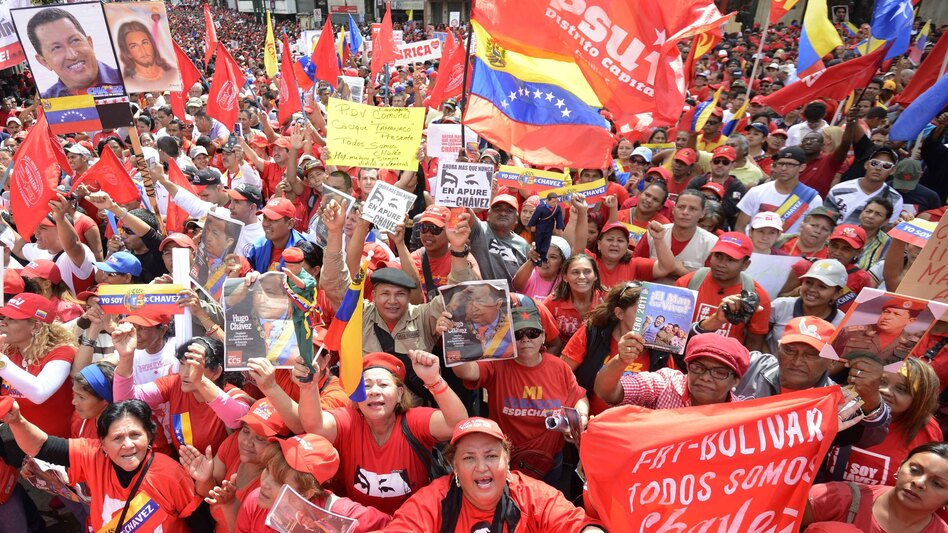 Venezuelan President Hugo Chavez remained in Cuba, where he's receiving treatment for cancer, and was not present for his planned inauguration in Caracas on Thursday. However, thousands of supporters gathered outside the presidential palace to show their backing. (AFP/Getty Images)
