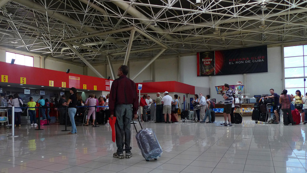 A traveler stands at the check-in lobby at Havana's Jose Marti International Airport last year. On Jan. 14, Cuba scraps a much-reviled, decades-old exit permit requirement, easing most Cubans' exit and return. (Reuters/Landov)