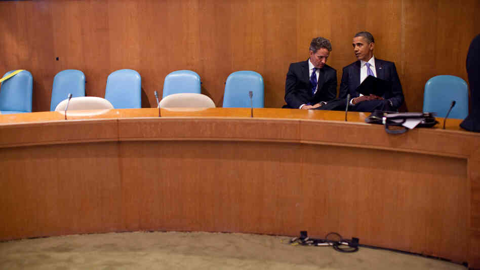 In this handout image provided by the White House, President Obama talks with Treasury Secretary Timothy Geithner at the United