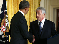 President Barack Obama shakes hands with former Sen. Chuck Hagel, R-Neb.
