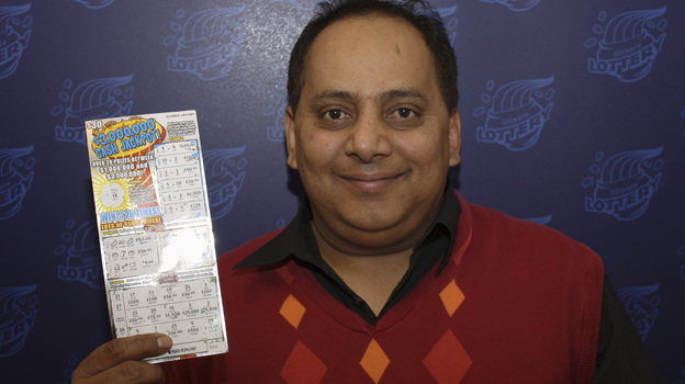 Urooj Khan poses with a winning lottery ticket. He died after winning a $1 million lottery in Chicago. Forensic pathologists at first said Khan died of natural causes, but that ruling was later changed to death by cyanide poisoning. (AP)