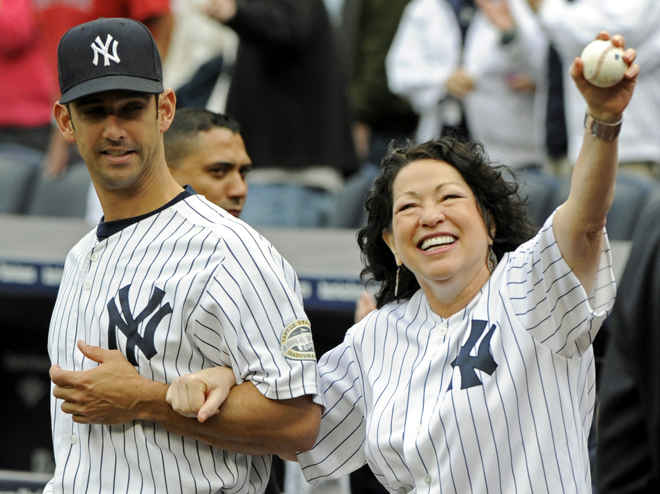 Sotomayor is escorted onto the field by New York Yankees catcher Jorge Posada to throw out the ceremonial first pitch before the New York Yankees game against the Boston Red Sox on Sept. 26, 2009 at Yankee Stadium in New York. (AP)