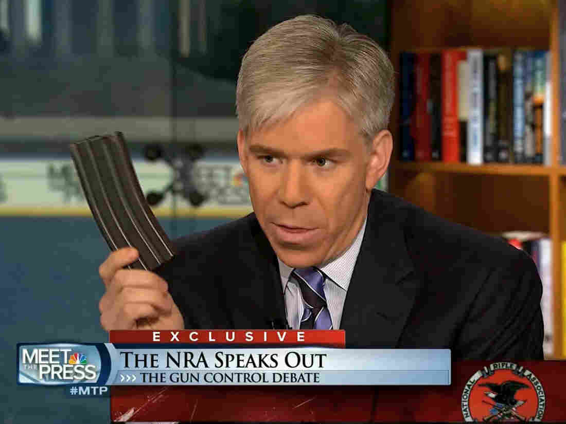 Meet the Press host David Gregory holds what he described as a high-capacity ammunition magazine during the Dec. 23 program.