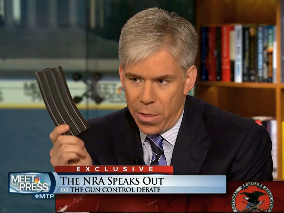 <em>Meet the Press</em> host David Gregory holds what he described as a high-capacity ammunition magazine during the Dec. 23 program.