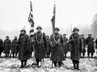 Members of the Japanese-American 442nd Combat Team stand at attention on Nov. 12, 1944. The National WWII Museum in New Orleans asks visitors to consider the dilemma Japanese-Americans faced when they were asked to enlist.
