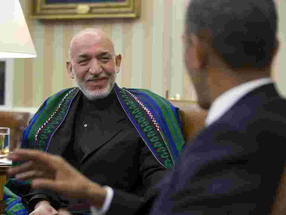 Afghan President Hamid Karzai smiled as President Obama gestured earlier today in the Oval Office.