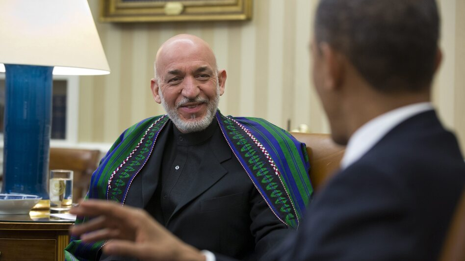 Afghan President Hamid Karzai smiled as President Obama gestured earlier today in the Oval Office. (EPA /LANDOV)