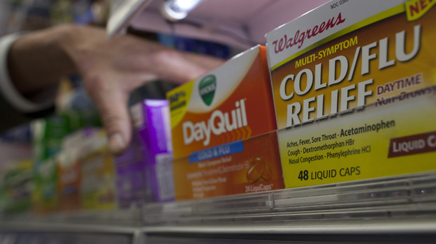 Reaching for relief: A customer at a pharmacy in New York City was grabbing some medicine on Thursday. (Reuters /Landov)