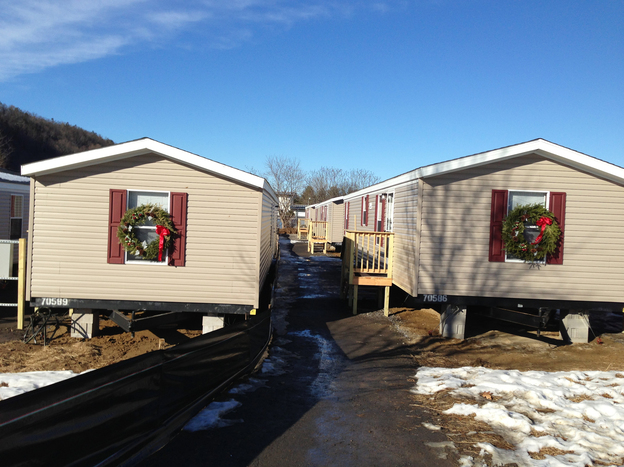 This brand-new neighborhood of mobile homes in New Milford, Conn., is home to 13 families from New York who  relocated after Superstorm Sandy. They've agreed to move out after a year, and will have a chance to buy the mobile homes afterward.