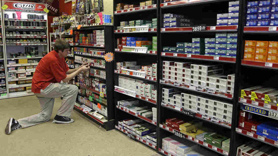 A clerk prices cigarettes at  Discount Smoke Shop in Ballwin, Mo. The Food and Drug Administration, which must approve all new tobacco products or any changes to existing brands, has not cleared any products since assuming that responsibility in 2009.