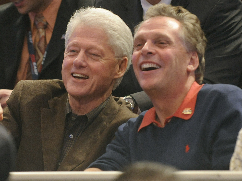 Former Democratic National Committee chairman Terry McAulliffe watches the Big East basketball tournament with former President Bill Clinton on March 11, 2010, in New York. (AP)