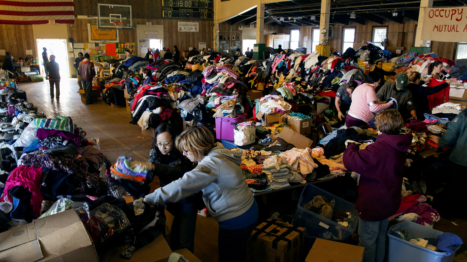 Thousands of food and clothing items are organized by Occupy Sandy volunteers in a school gymnasium in Rockaway Park, Queens, after Superstorm Sandy in November.