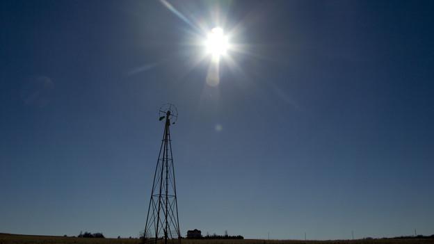 The sun shines above a farm near White City, Kan., in November. (AP)