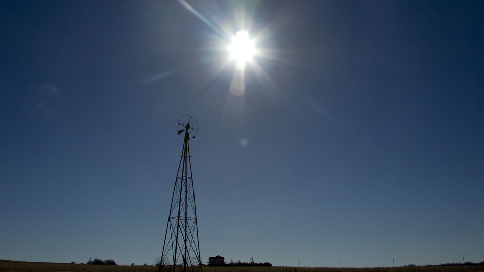The sun shines above a farm near White City, Kan., in November. (AP)