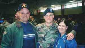 Lance Pilgrim with his parents, Randy and Judy, at the pre-deployment ceremony at Fort Sill, Okla., in January 2003.