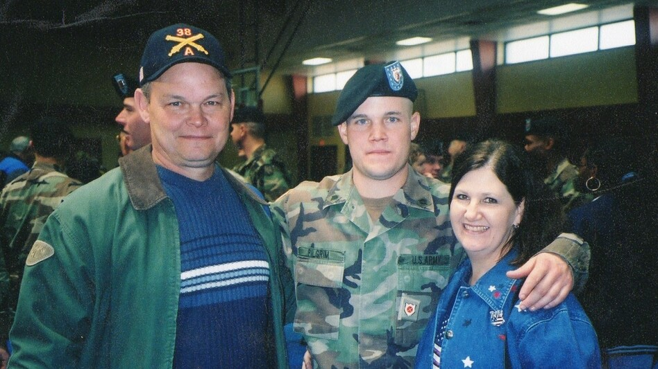 Lance Pilgrim with his parents, Randy and Judy, at the pre-deployment ceremony at Fort Sill, Okla., in January 2003. (Courtesy of Judy Pilgrim)
