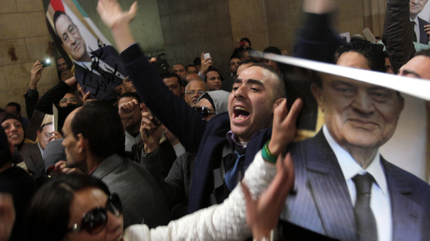 Egyptians supporters of ousted former President Hosni Mubarak celebrate an appeal granted by a court in Cairo, Egypt, Sunday. (AP)