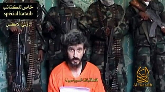 An undated screen image of footage shot by Al-Kataib Media, showing Denis Allex, a French hostage allegedly held by Somali militants, who was reportedly killed during the  failed rescue mission.