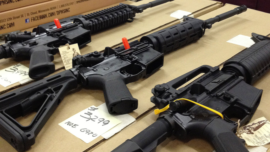 Rifles are displayed at a gun show in Marietta, Ga., on Dec. 22, 2012. A new poll shows overwhelming and bipartisan support for requiring criminal background checks before the sale of firearms at gun shows, as is already required before store sales. (AP)