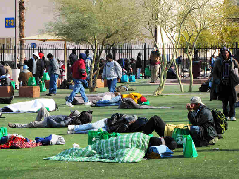 The homeless battle freezing temperatures outside Central Arizona Shelter Services near downtown Phoenix.