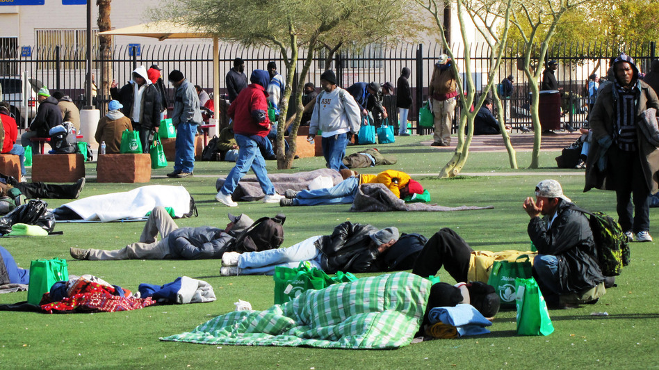 The homeless battle freezing temperatures outside Central Arizona Shelter Services near downtown Phoenix. (KJZZ)