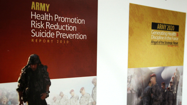 """U.S. military suicides rose in 2012. Here, the Army's """"Generating Health and Discipline in the Force"""" report, right, is seen last January. The reports was a follow-up to its """"Health Promotion/Risk Reduction/Suicide Prevention"""" report. (Getty Images)"""