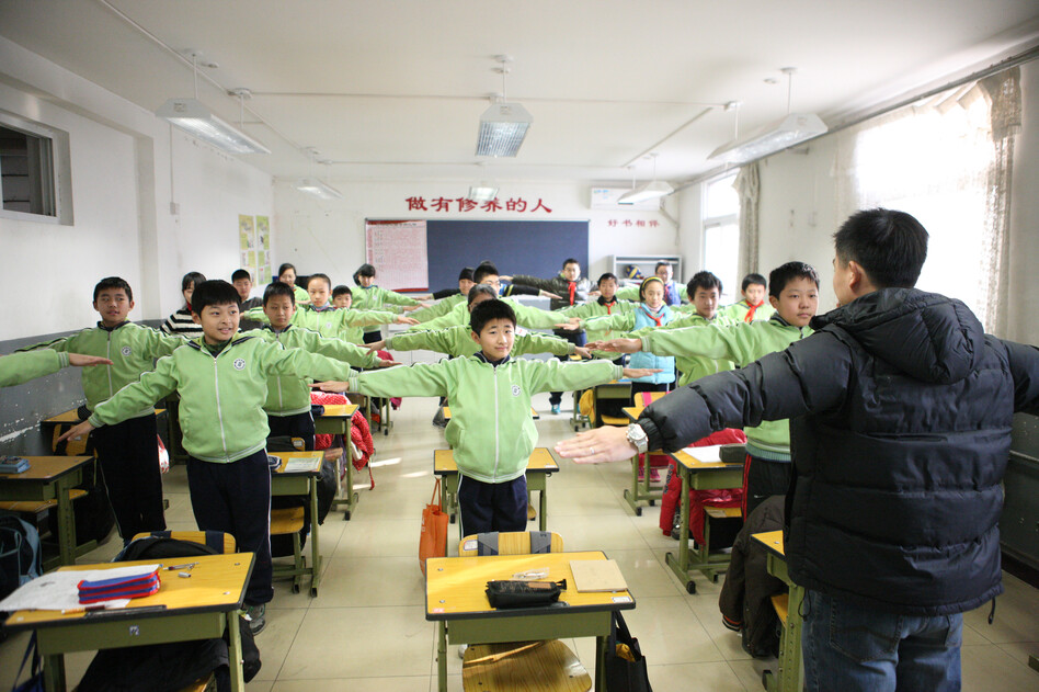 Students take an indoor physical education class at Shoushuihe Elementary School in Beijing, as outdoor sports activities for primary and middle schools were halted due to heavy air pollution. Heavy smog has caused highway closures and flight delays in several provinces. (Xinhua /Landov)