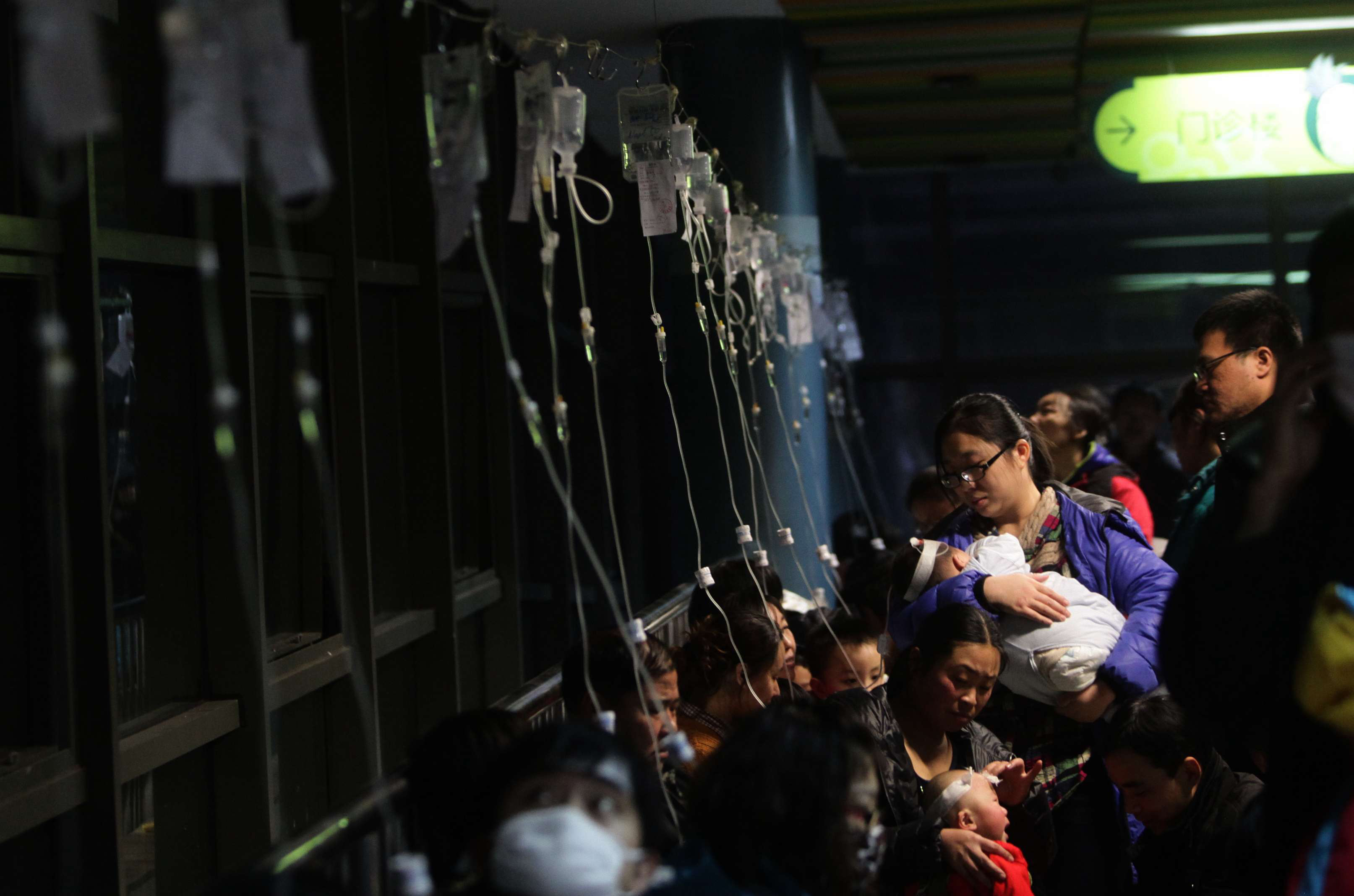 Beijing hospitals saw a spike in respiratory cases Monday following a weekend of off-the-charts pollution. Here, a row of intravenous drips is seen as parents take their kids to hospital for flu treatment Sunday.