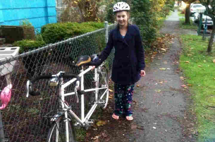 Courtney Forbes, 21, stands with the tandem bicycle that she and her husband, Harly relied on for transportation before it was stolen last week. They plan to donate the bike, which has since been returned, to the Washington School for the Blind.