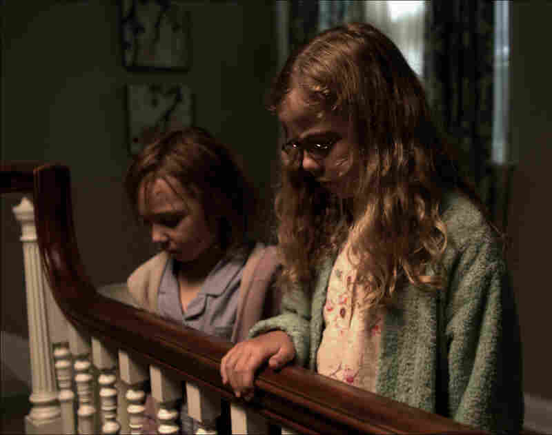 Lilly and Victoria provide a haunting presence at the heart of Mama, a horror film backed by executive producer Guillermo del Toro.