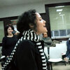 """A woman sings """"Here Comes the Sun"""" by the Beatles in an unemployment office in Spain as part of a flash mob organized to cheer up those waiting in the office to find work."""