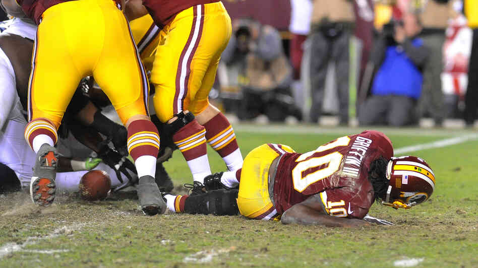 Redskins quarterback Robert Griffin III lays on the field after injuring his knee during an NFL playoff loss to the Seattle Seahawks on January 6. Griffin had knee surgery two days later.