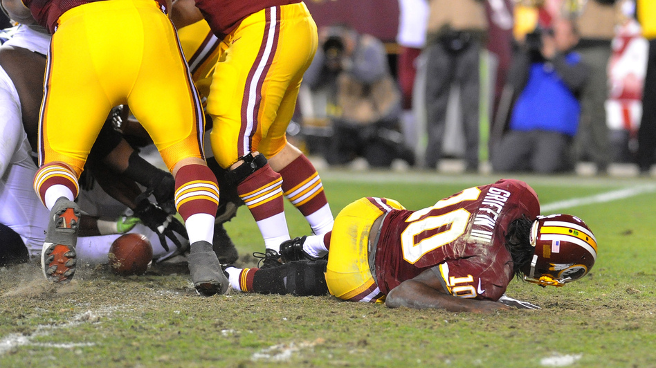 Redskins quarterback Robert Griffin III lays on the field after injuring his knee during an NFL playoff loss to the Seattle Seahawks on January 6. Griffin had knee surgery two days later. (AP)