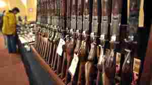 Shotguns sit on display at a gun show in Stamford, Conn., last week. Demand has risen for firearms as the White House prepares its new plan for gun control measures. New surveys find that a majority of Americans support some measures.