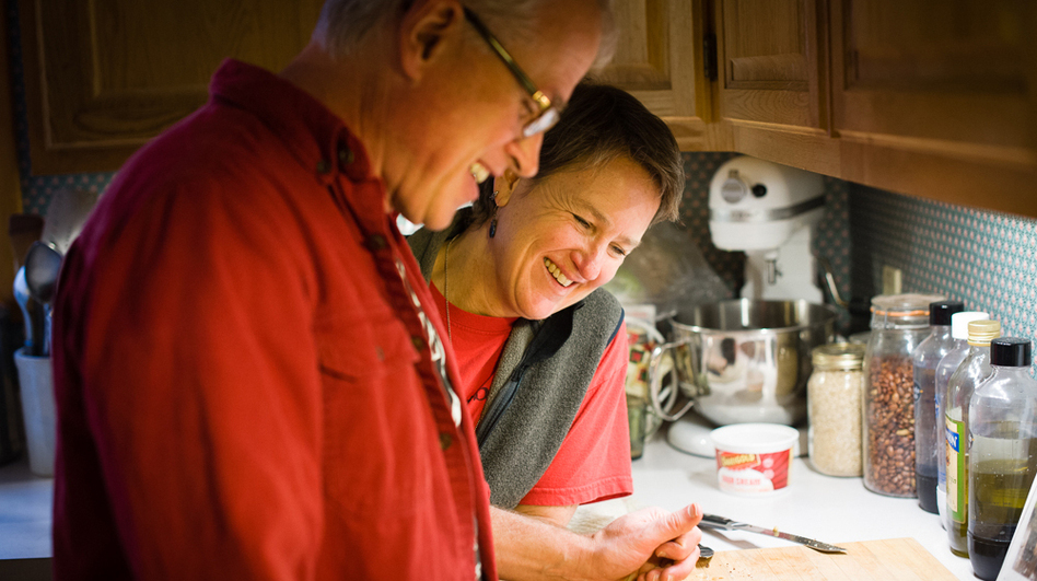 Mike Bixby and Maria Peyer at their home in Longview, Wash. They have been married for two and half years but have known each other since 1981. Peyer is a church-attending Lutheran, and Bixby is an atheist. (Leah Nash for NPR)