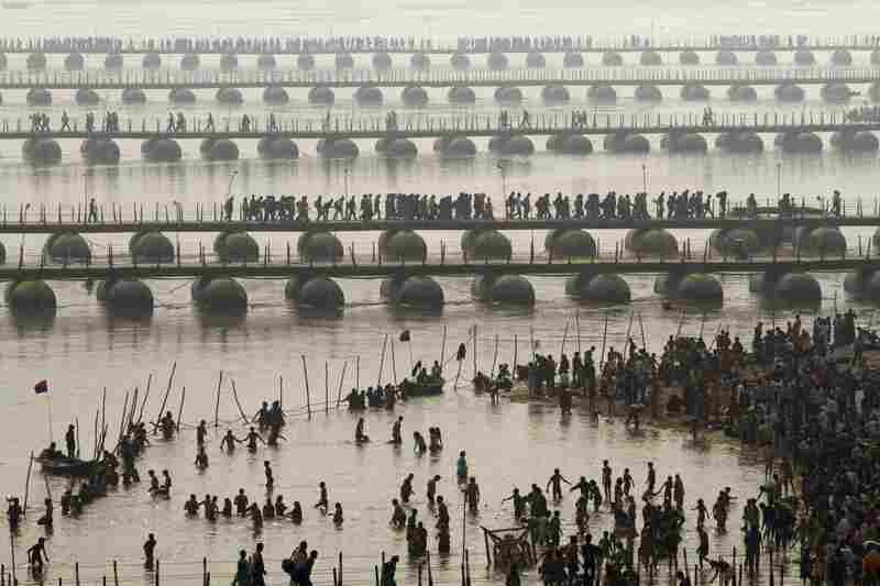 Hundreds of thousands of Hindu pilgrims led by naked, ash-covered holy men stream into the sacred waters Monday at the start of the world's biggest religious festival.
