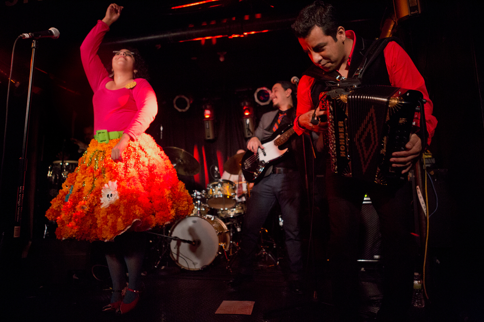 """The Los Angeles-based trio La Santa Cecilia showed off its soulful mix of Mexican and South American-influenced dance pop to the globalFEST crowds. The band also did its own take of U2's hit song """"One."""""""