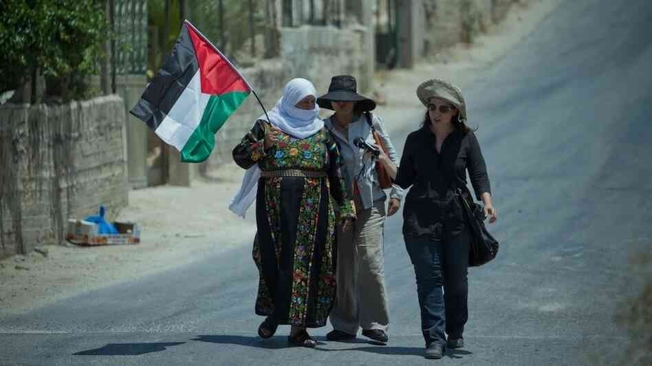 NPR correspondent Lourdes Garcia-Navarro (right) conducts an interview in the West Bank.